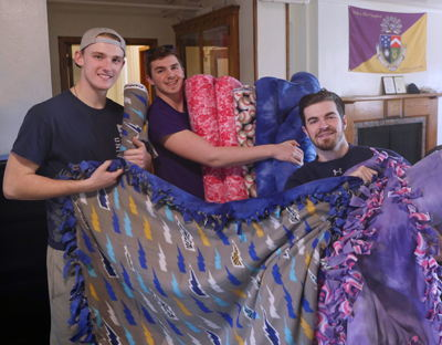 Lawrence Delts Donate Handmade Blankets to Hospital