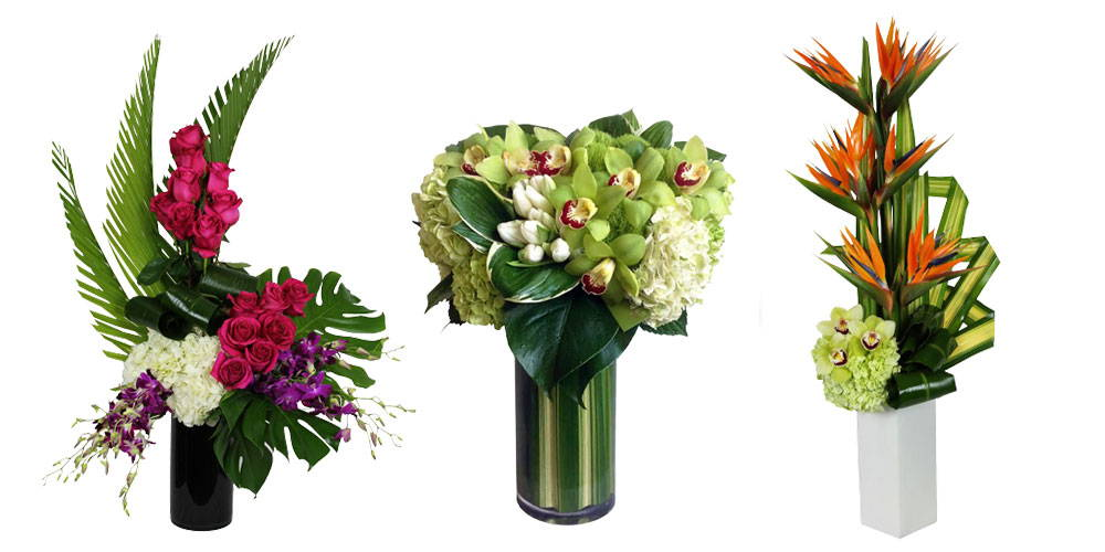 Picture of three luxury tall arrangements with roses, orchids and tropical flowers