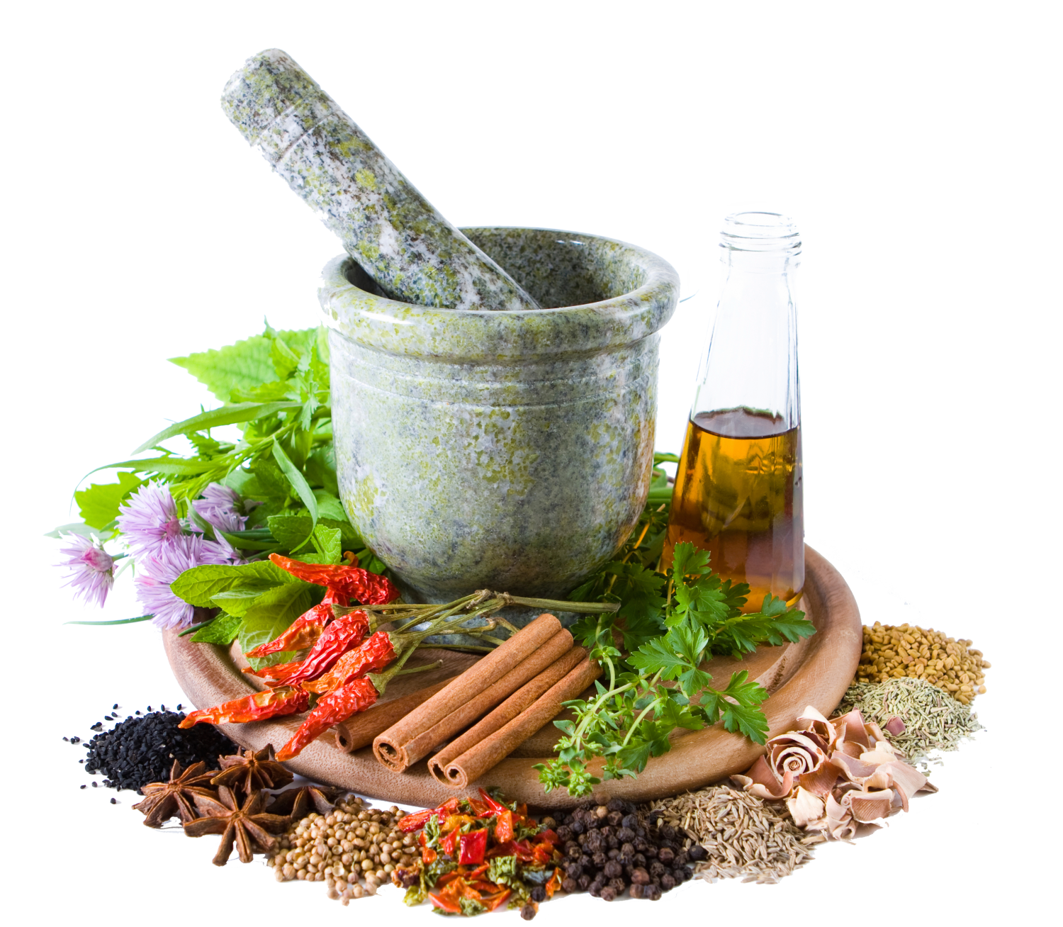 pestle and mortar with collection of ayurvedic herbs