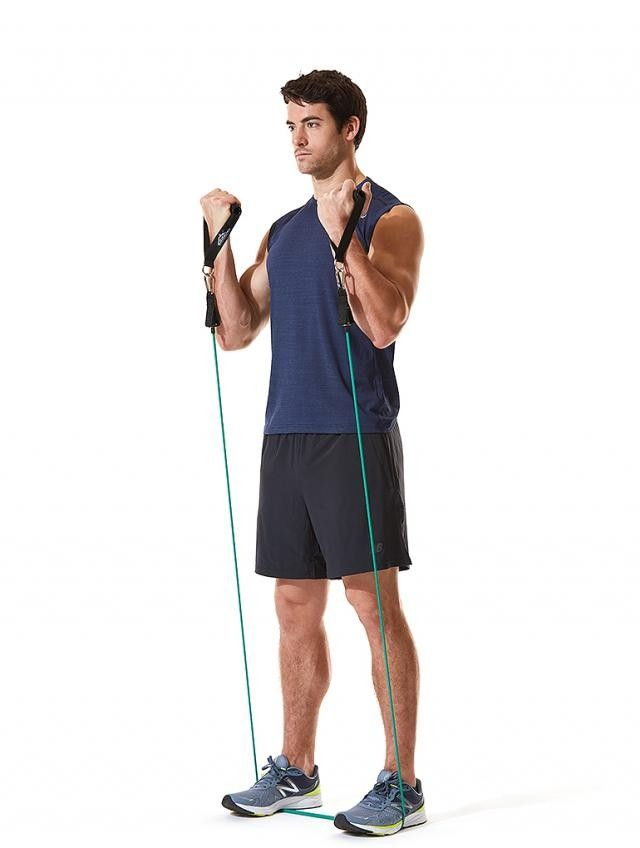 Stand in the middle of the resistance band