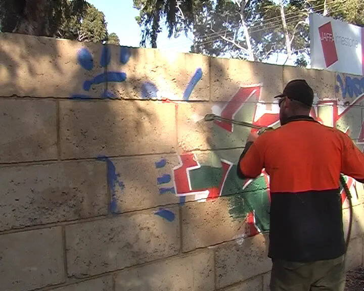 removing graffiti from wall protected with worlds best graffiti coating