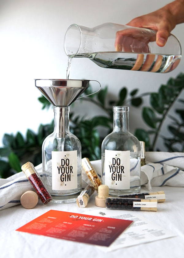 Pouring alcohol into the gin making kit