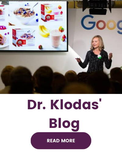 """Image shows Dr. Elizabeth Klodas presenting on a stage with a presentation behind her featuring Step One products. The text below the image reads Dr. Klodas Blog with a button that says """"read more""""."""