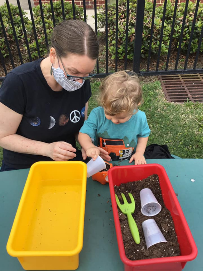 child planting wildflowers with their parent at Primrose School of Clear Lake, daycare and child care in Clear Lake, TX 77062