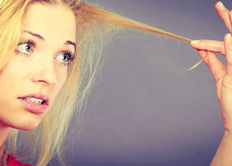 woman holding split ends
