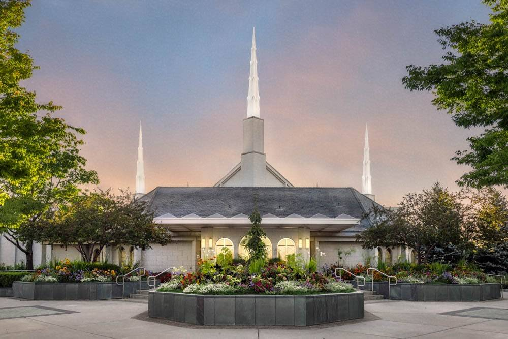 Photo of the Boise Idaho Temple, featuring a large flowerbed.