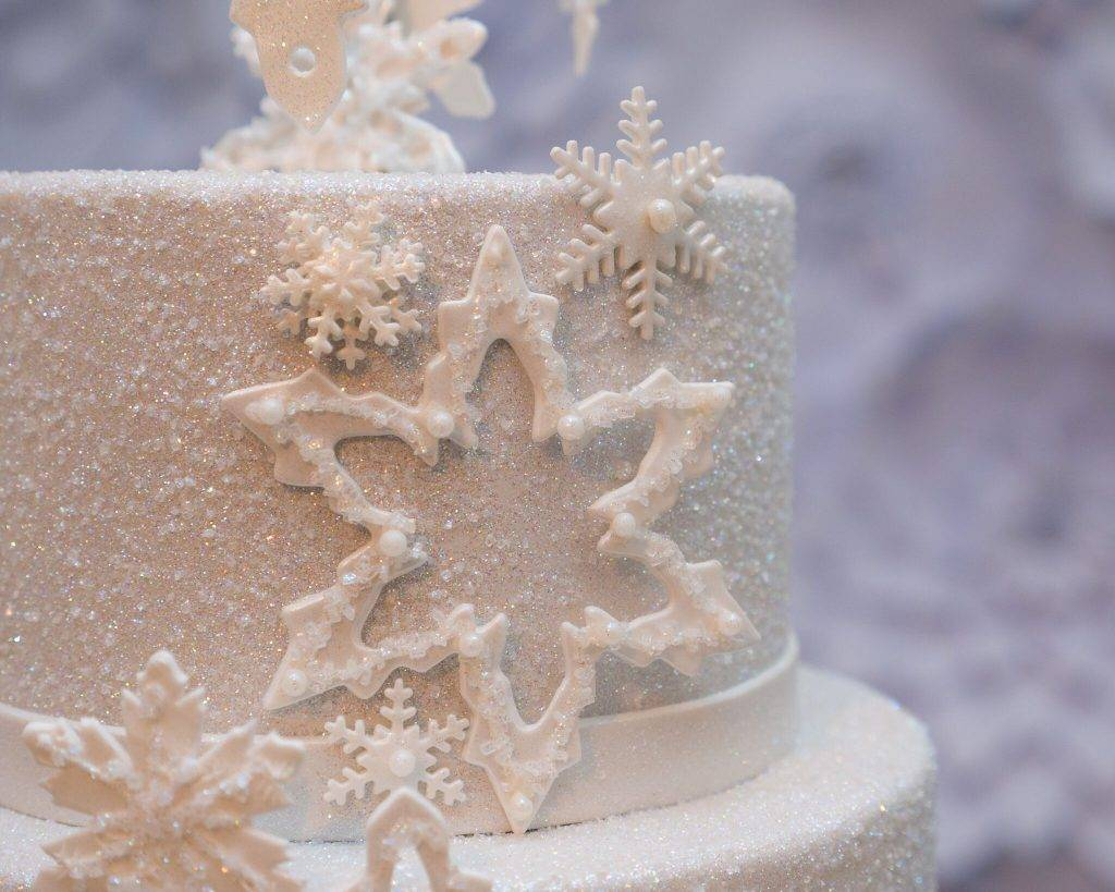 Christmas-themed cake with snowflake details and sugar coating.