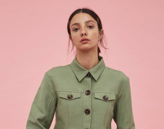 a woman wears a green shirt
