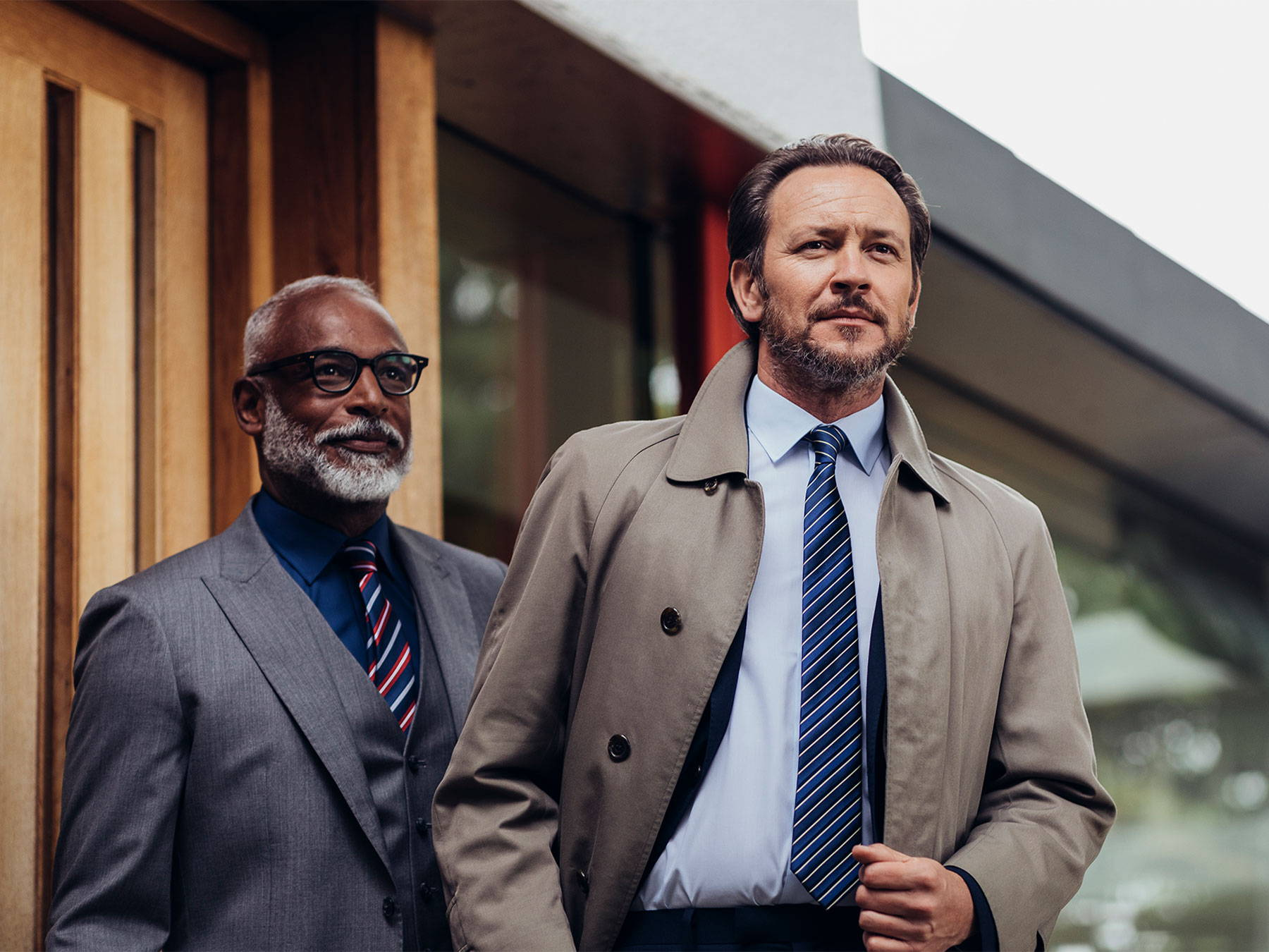 Two men in smart work attire