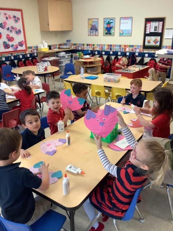 Photo of Pre-K students making Valentine's Day crafts