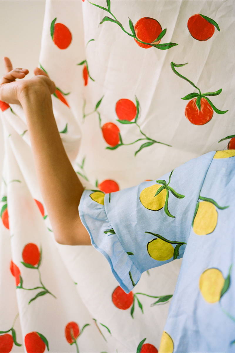 YOLKE's Jacquard White Cotton Classic Pyjamas holding Alighieri jewellery in a pot