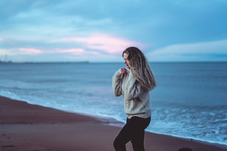 Image of abi walking on a beach