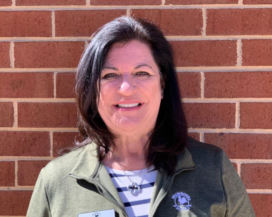 Ms. Cooper , School Director