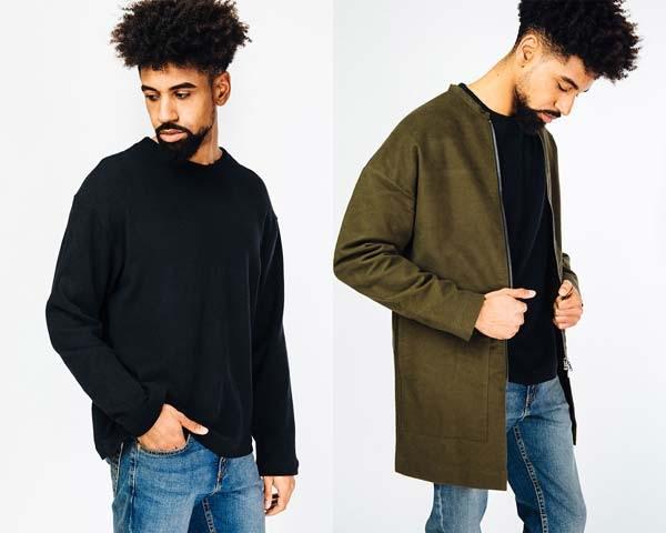 Man wearing black organic cotton crewneck sweatshirt with blue denim and man wearing olive green collarless jacket along with light wash indigo denim