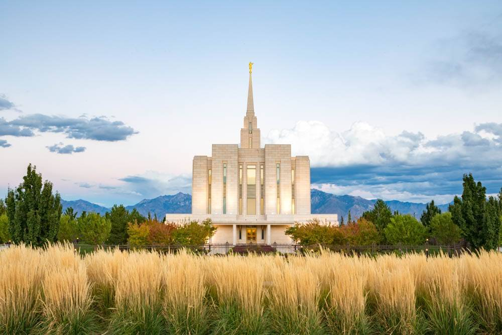 LDS art photo of the Oquirrh Mt Temple amid fall trees and a field.