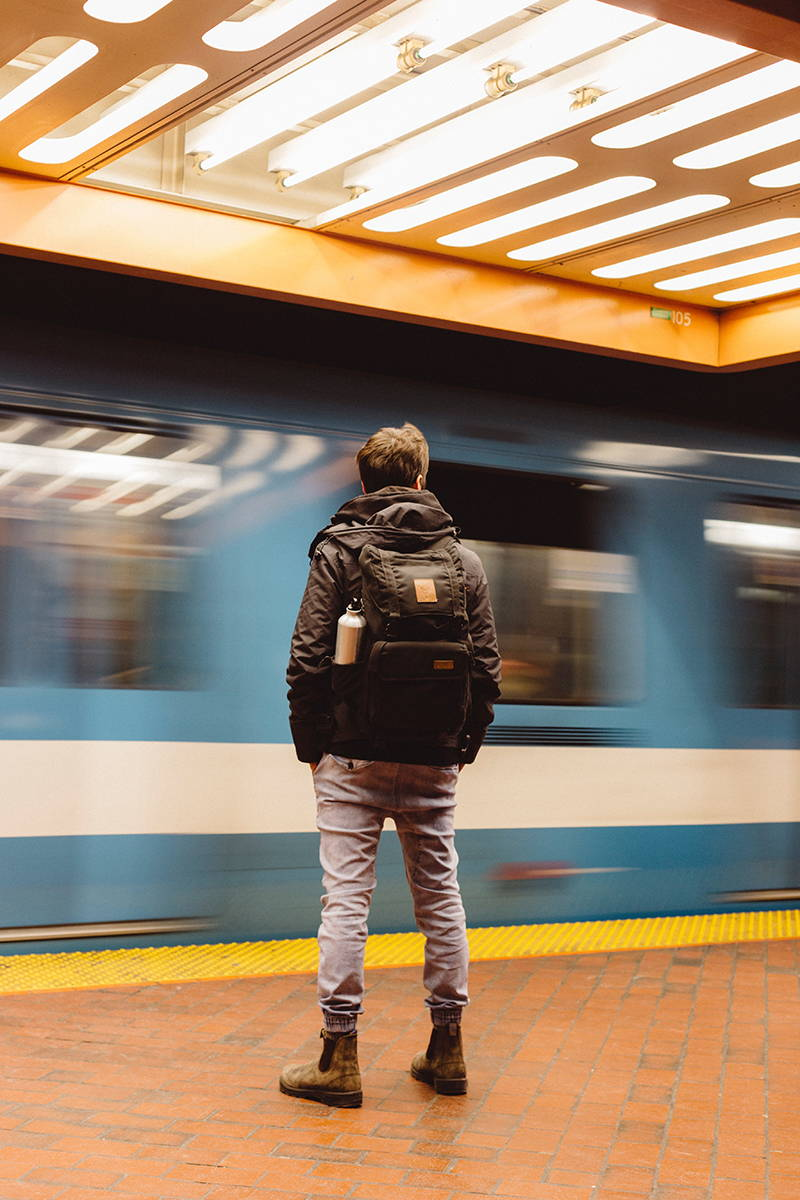 a man waiting for the subway in Montreal