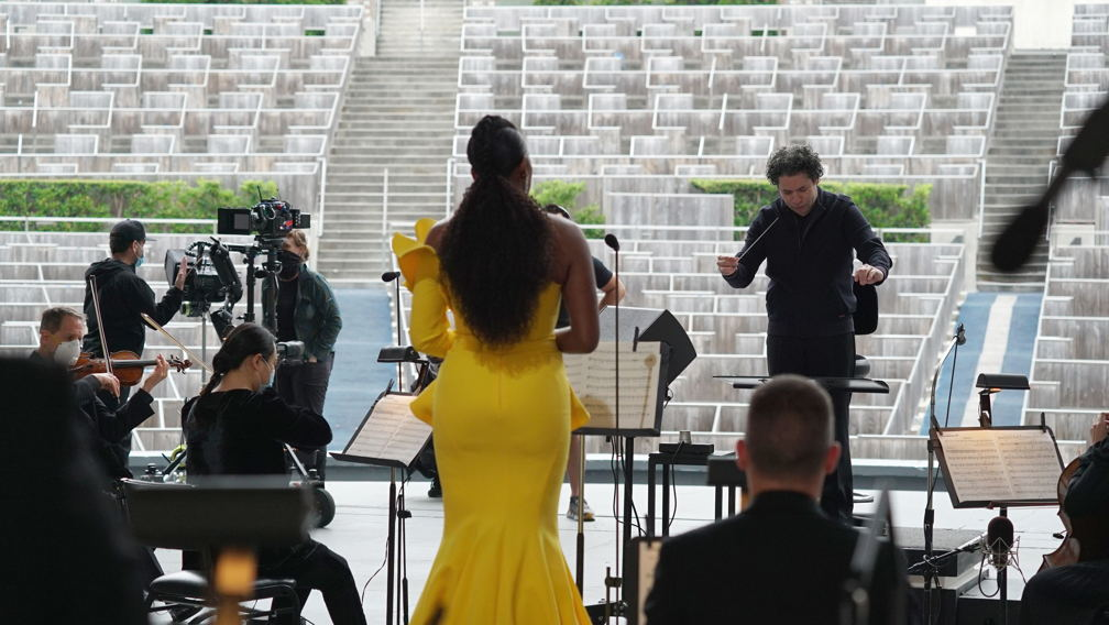 Gustavo Dudamel and J'Nai Bridges performing on the Bowl stage to an empty audience