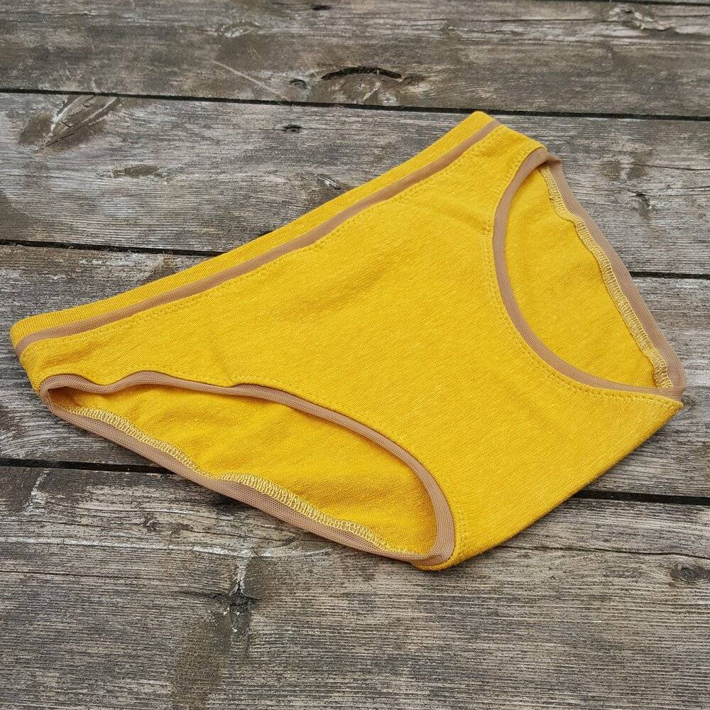 a paid of Valkyrie high waisted underwear in mustard yellow