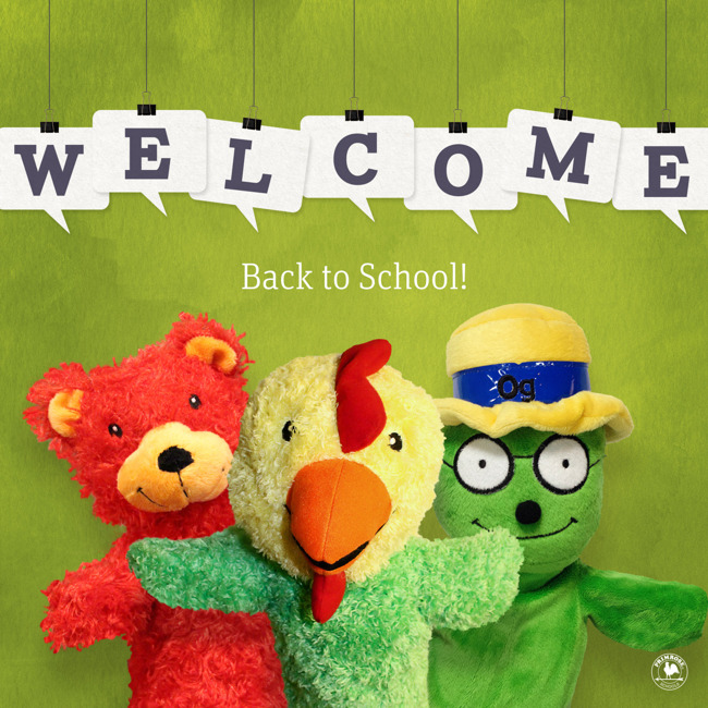 """3 Primrose puppets ( a bear, a rooster, and a caterpillar) stand under a sign that says """"Welcome Back to School"""""""