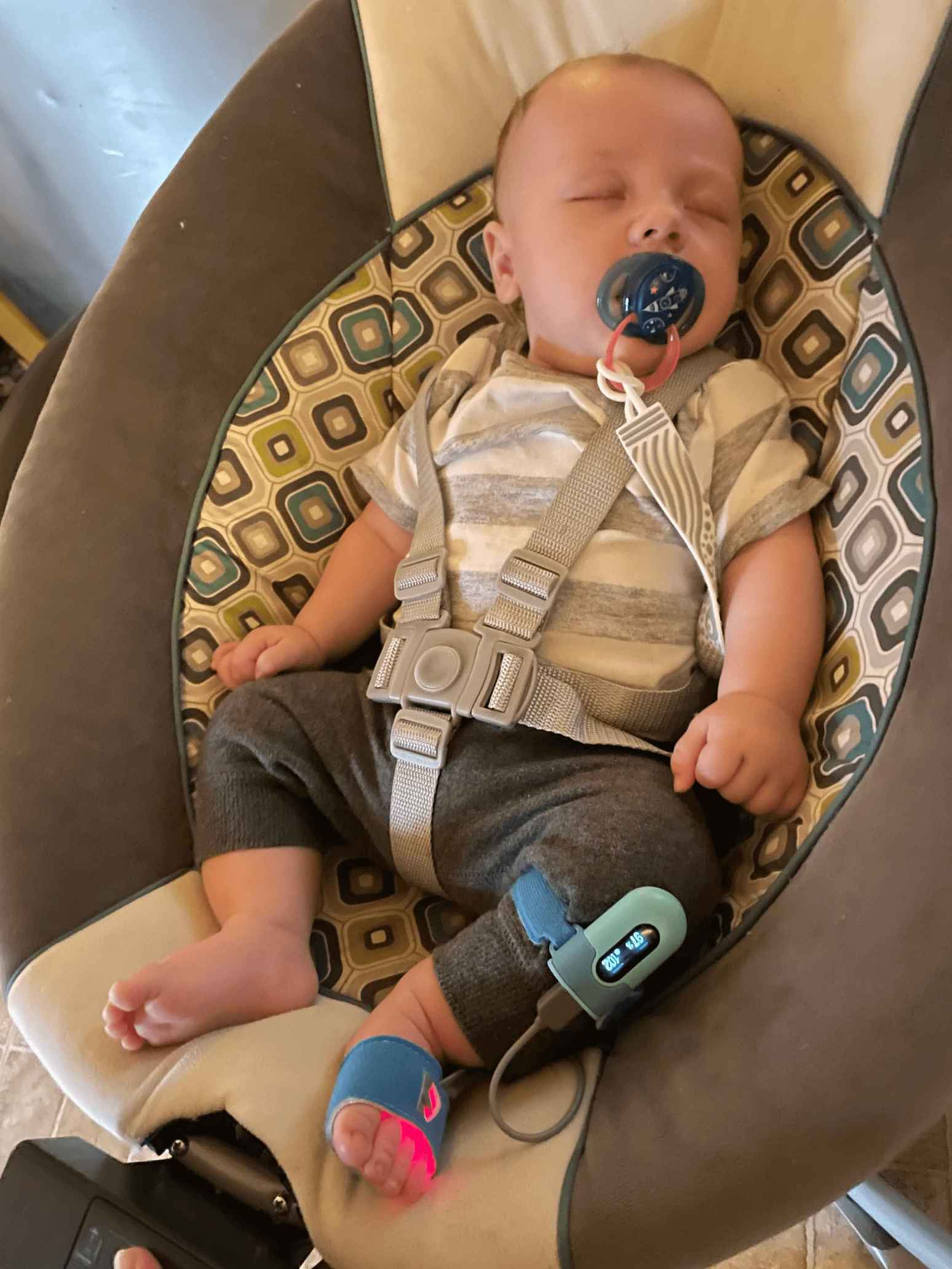 Mrs Hendrix's son is wearing Wellue Baby O2 peacefully in his chair.