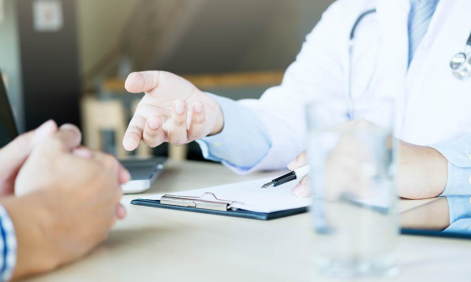 doctor's hands with a clip board