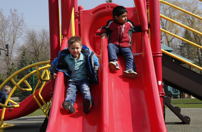 Image of little boys sliding