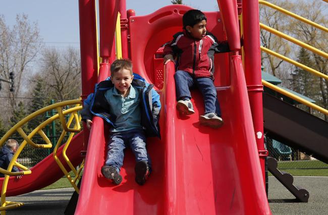 Image of little boys sliding