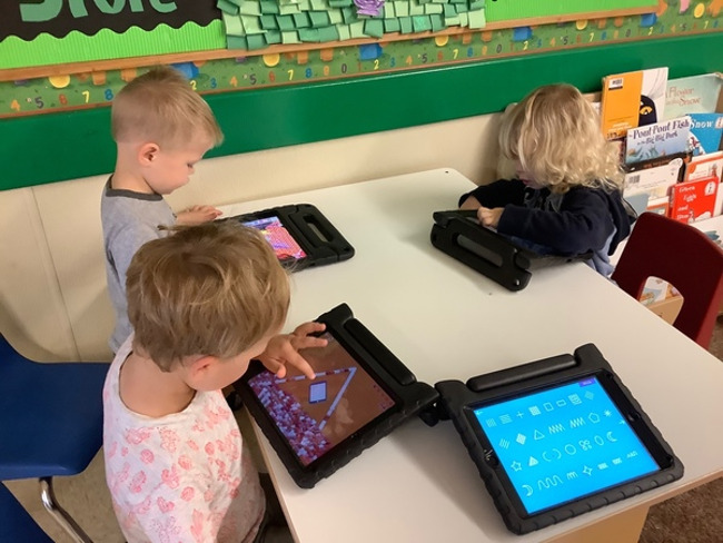 Our Preschoolers are developing a sense of independence while exploring our Technology tablets.