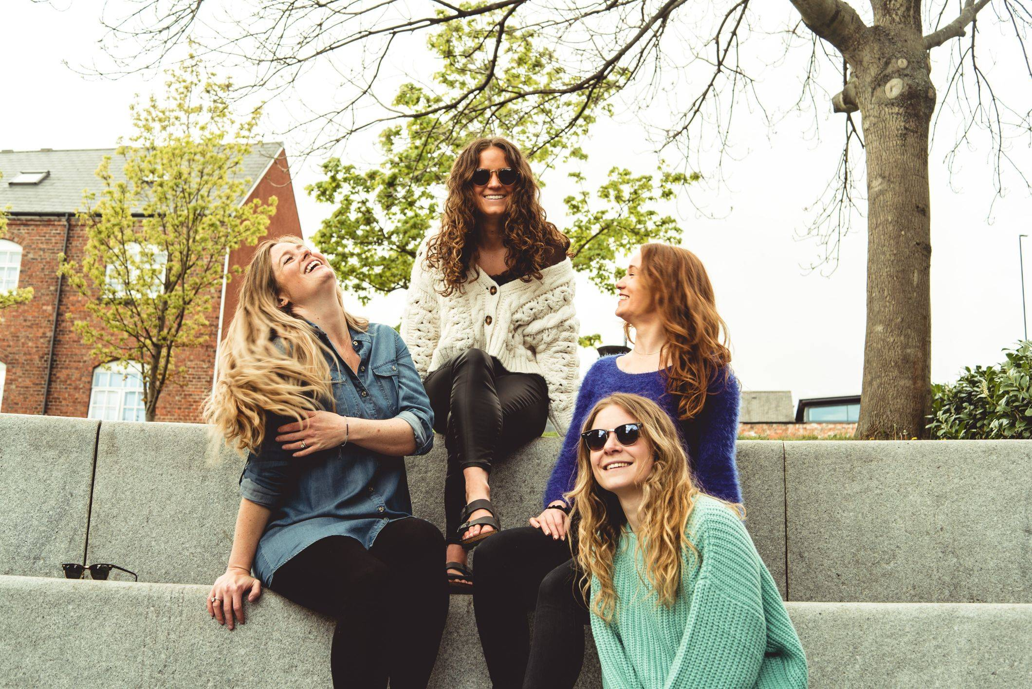 Image of girls sitting on steps laughing