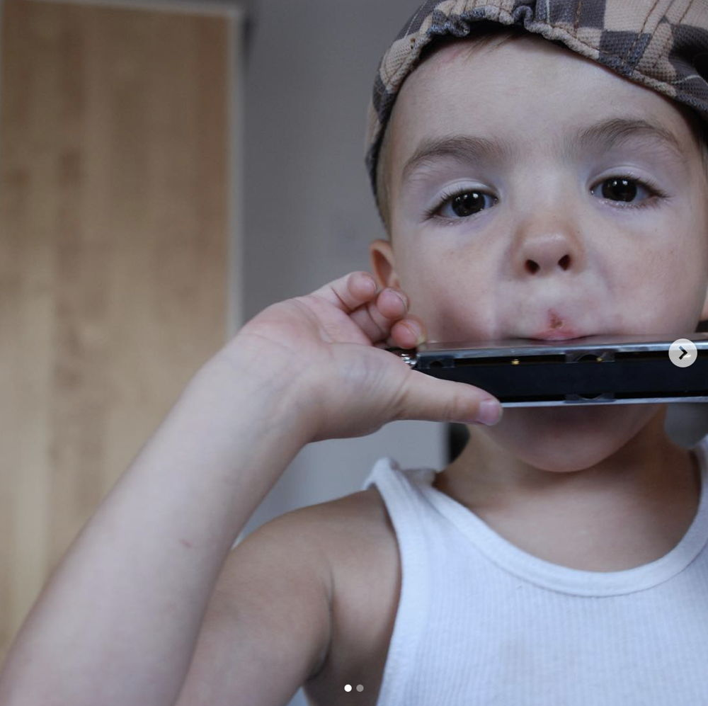 A child playing the harmonica