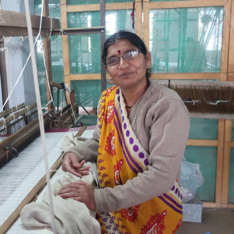 woman with bindi on hand loom