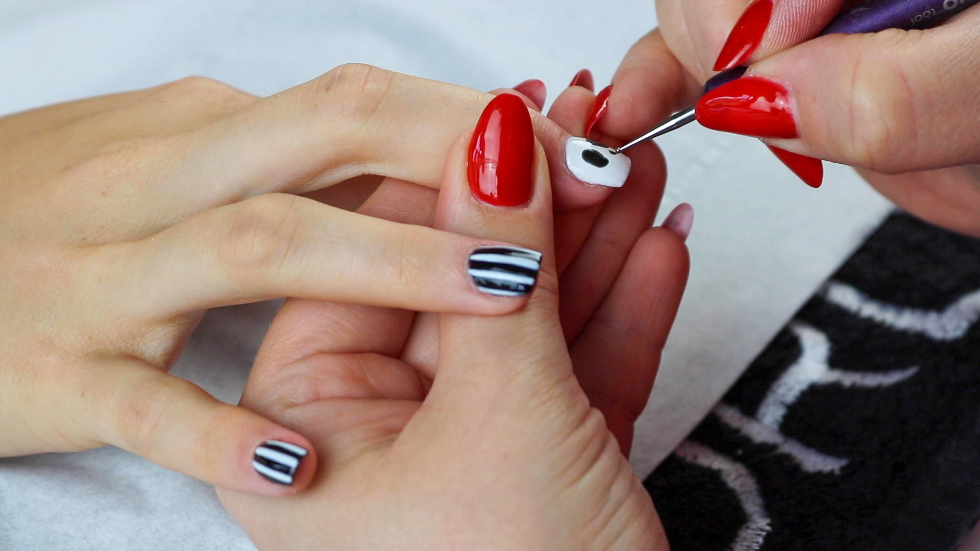 Jack Skellington nails nose detailing being added to nails using ORLY Liquid Vinyl