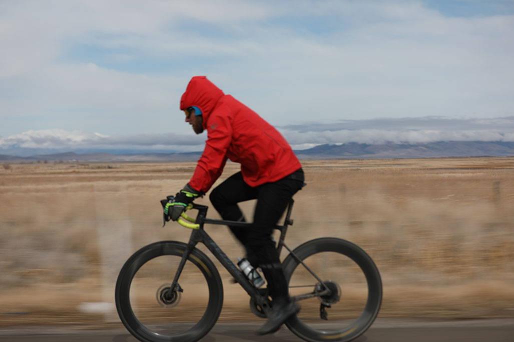 biking in rain jacket profile