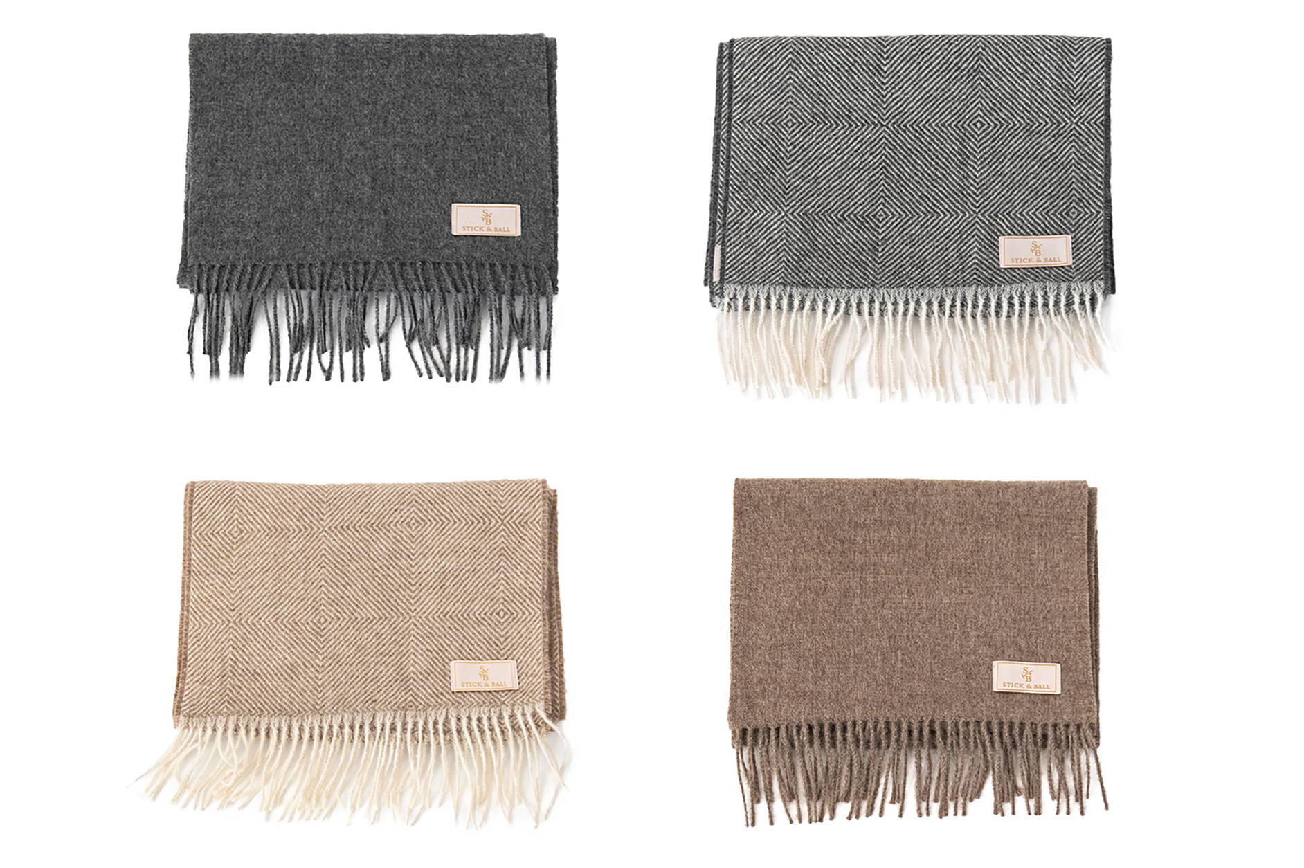Display of Alpaca Scarves in solid charcoal and taupe colors & with diamond motif pattern - Stick & Ball