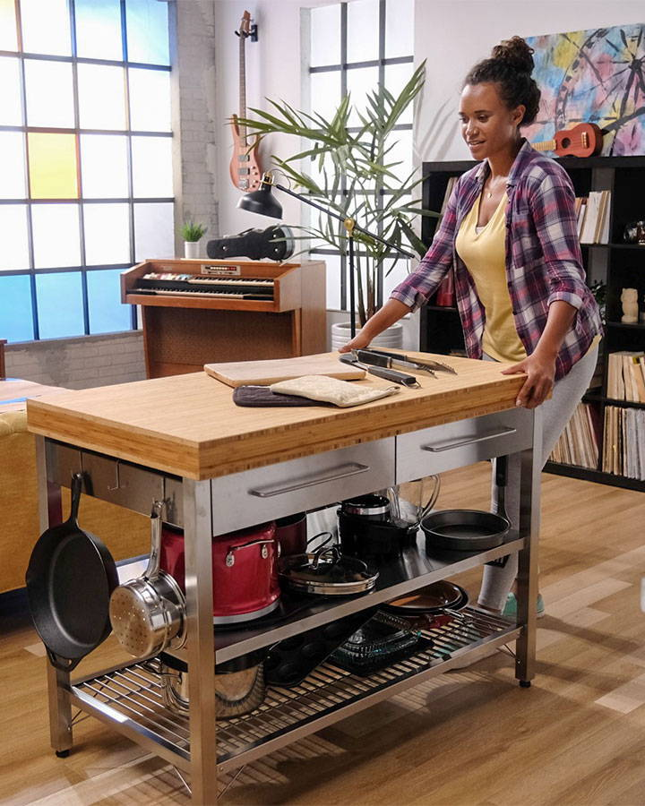 Young woman using magic sliders to move kitchen island