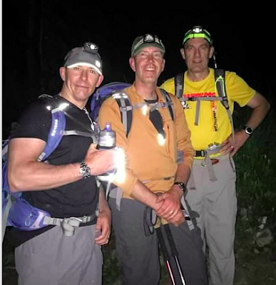 Chris Riggio Alex Potts and Skip Schweiss navigate the pitch-dark trail.