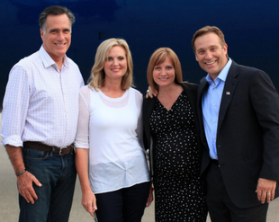 The Romneys and the Matsons get photographed in front of the campaign jet.
