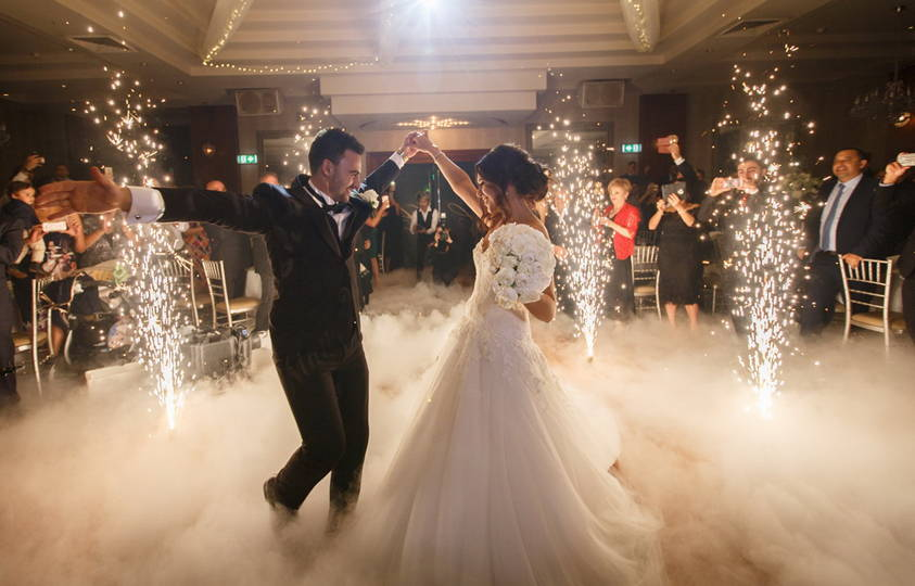 couple dancing at wedding reception with lightspark lighting