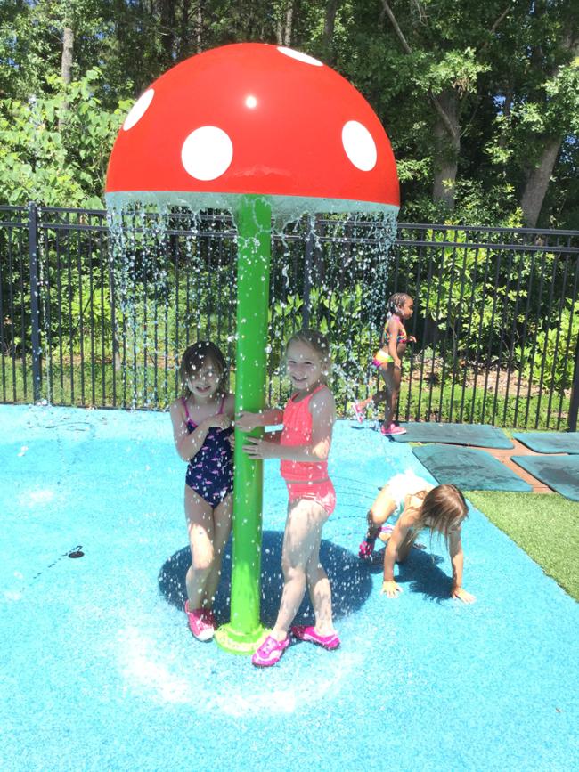 students on splash pad