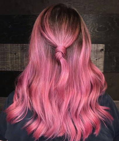 back view of woman with pink hair