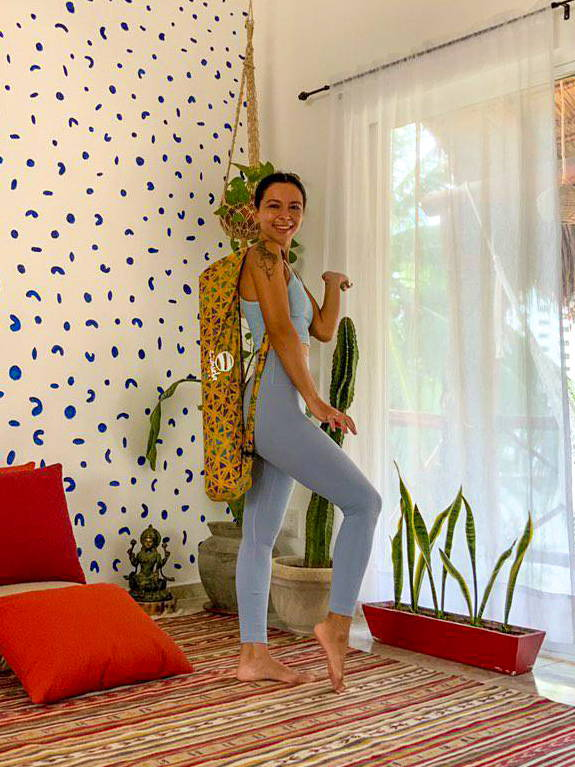 Vibrant yellow batik yoga mat bag on yoga teacher Dee  in Tulum