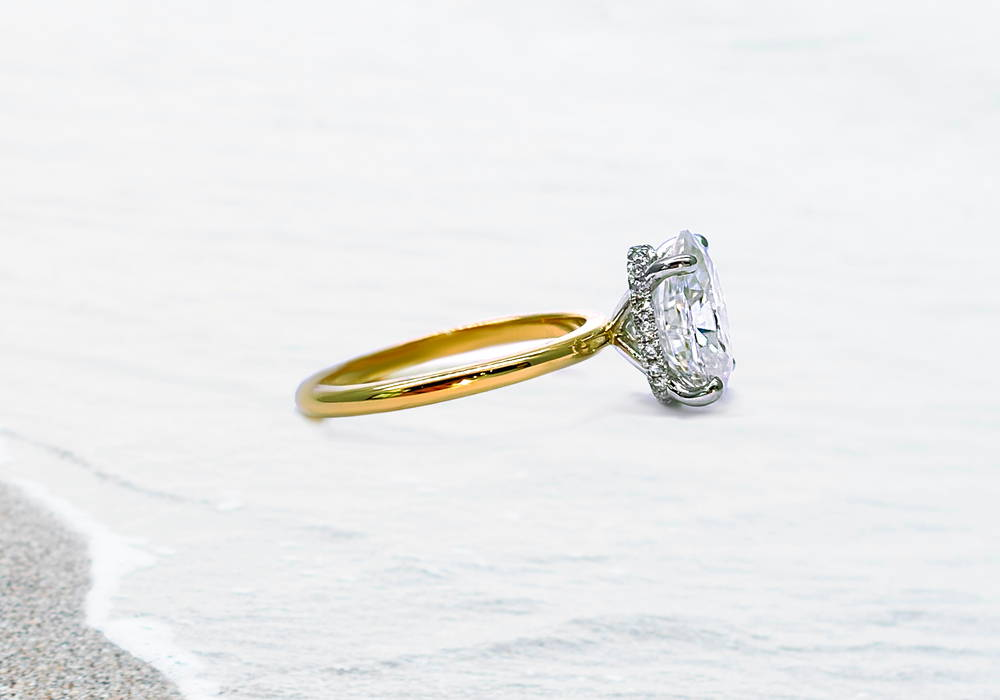 1 carat yellow gold solitaire with hidden halo