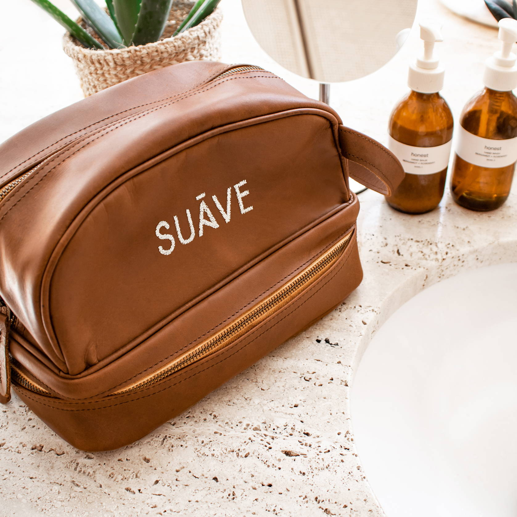 branded leather wash bag