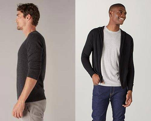 Man wearing charcoal cashmere crewneck jumper with light grey jeans and man wearing black cashmere zip up hoodie with a light grey t-shirt underneath and indigo blue jeans, jumpers both from sustainable Mongolian cashmere jumper brand Naadam