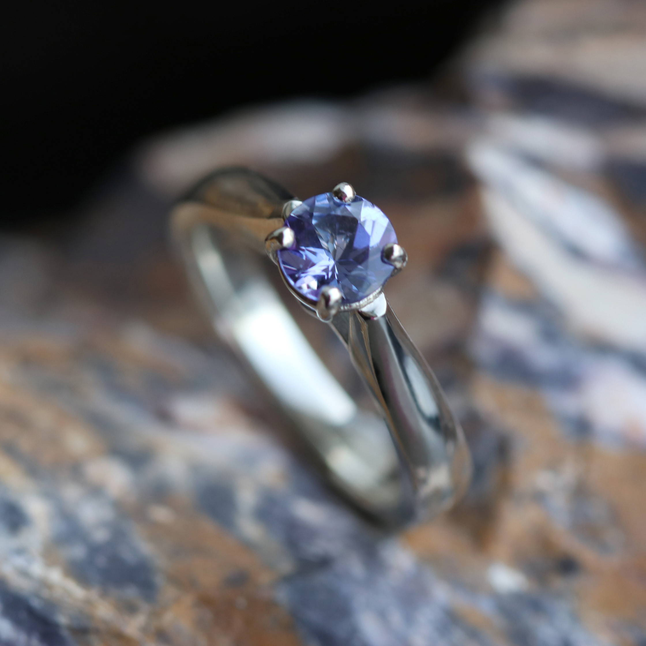 TANZANITE ENGAGEMENT RING WITH DIAMOND ACCENTS IN WHITE GOLD