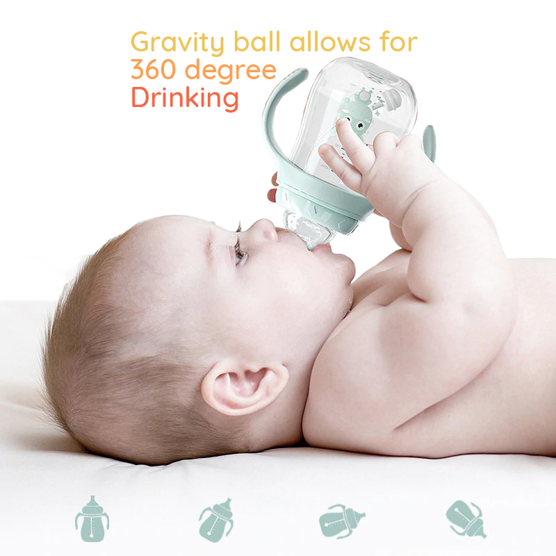 Baby lying on its baack drinking out of the SuperTots baby bottle with gravity ball which allows for 360 degree drinking