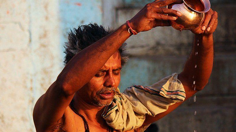 Morning pray by the Ganges river, Varanasi, India