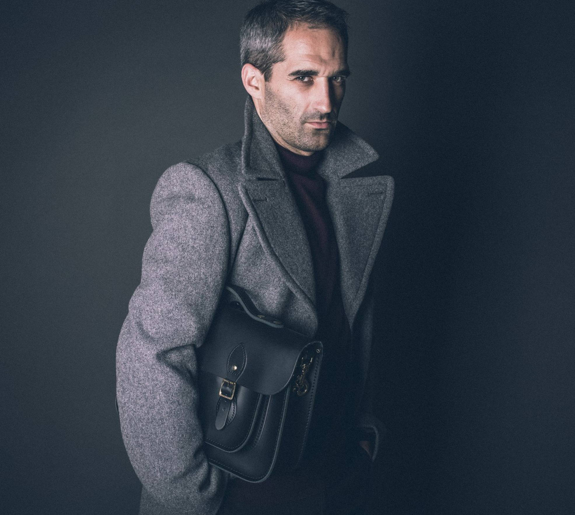 Man Wearing a Leather Briefcase