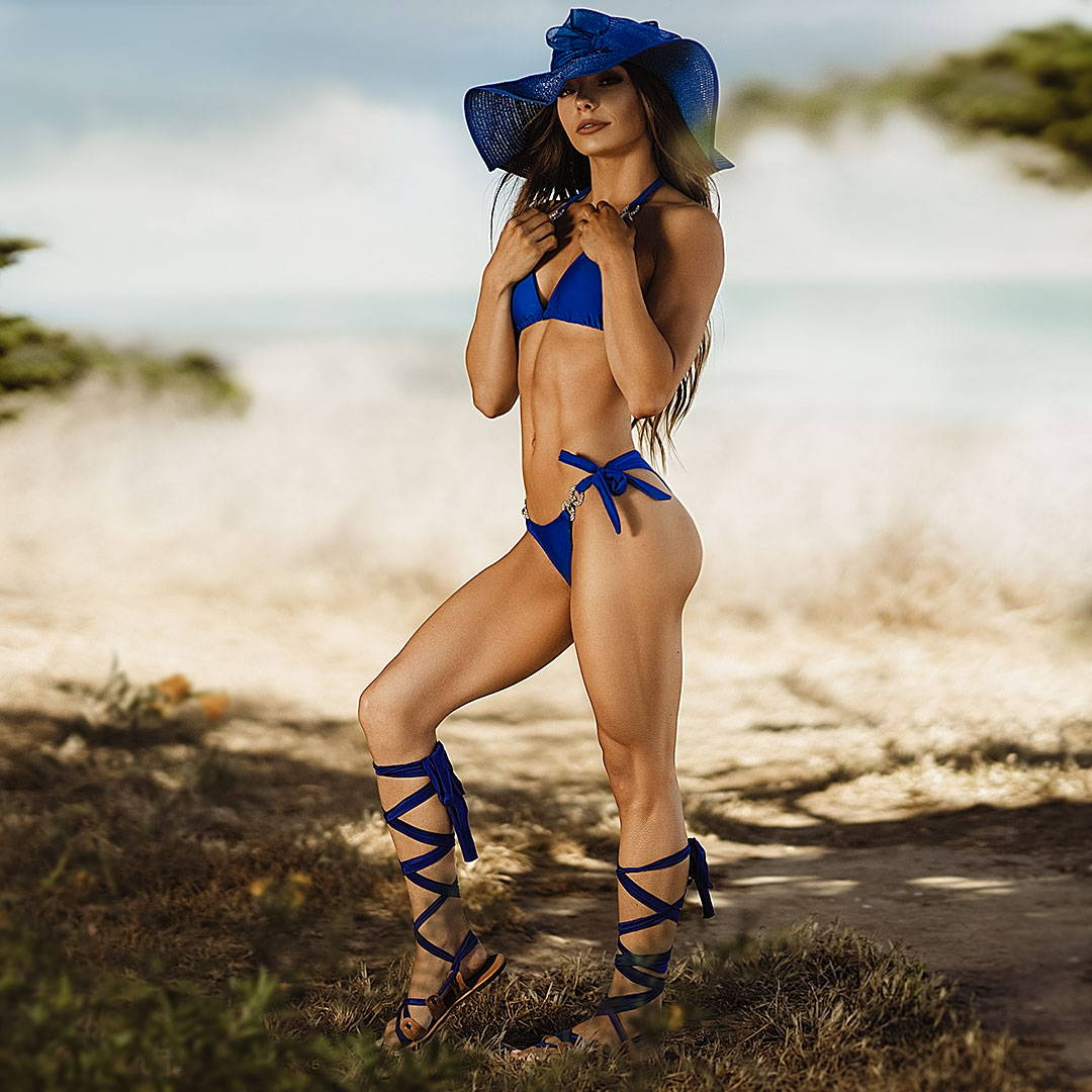 back view of girl in blue bikini and blue  straw hat
