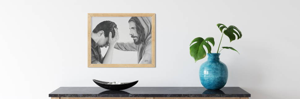 Image of a simple room setting featuring a sketch of Jesus comforing a young man.
